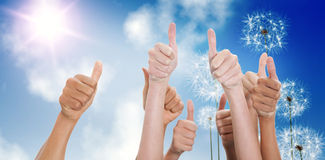 Composite image of hands up and thumbs raised Royalty Free Stock Images