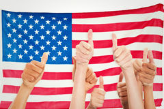 Composite image of hands up and thumbs raised Stock Photos