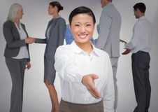 Composite image of Handshake in front of business people with white background Royalty Free Stock Photography