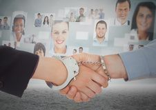 Composite image of Handshake with handcuffs in front of sky with business people Royalty Free Stock Image