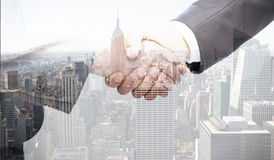 Composite image of handshake between two business people Royalty Free Stock Photography