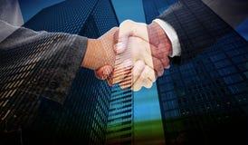 Composite image of handshake between two business people Stock Image