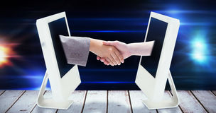 Composite image of handshake between two women Stock Photography
