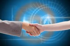 Composite image of handshake between two women Stock Image
