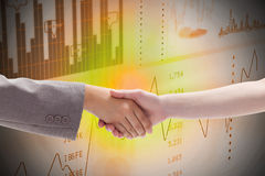 Composite image of handshake between two women Stock Photography