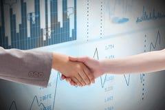 Composite image of handshake between two women Stock Photos
