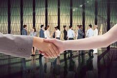 Composite image of handshake between two women Stock Images