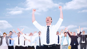 Composite image of handsome businessman cheering with arms up. Handsome businessman cheering with arms up against cloudy sky Stock Photos