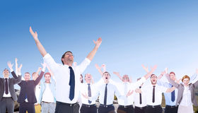Composite image of handsome businessman cheering with arms up. Handsome businessman cheering with arms up against mountain trail Royalty Free Stock Photography