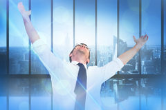 Composite image of handsome businessman cheering with arms up. Handsome businessman cheering with arms up against room with large window looking on city Royalty Free Stock Photos