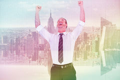 Composite image of handsome businessman cheering with arms up. Handsome businessman cheering with arms up against server room with towers Royalty Free Stock Photography