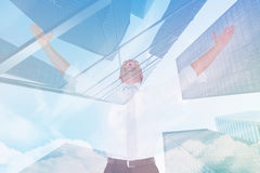 Composite image of handsome businessman cheering with arms up. Handsome businessman cheering with arms up against skyscraper Stock Image