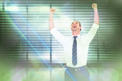Composite image of handsome businessman cheering with arms up. Handsome businessman cheering with arms up against window overlooking city Stock Images