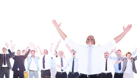 Composite image of handsome businessman cheering with arms up. In the air Royalty Free Stock Photos