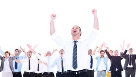 Composite image of handsome businessman cheering with arms up. In the air Stock Photos
