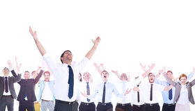 Composite image of handsome businessman cheering with arms up. With coworkers Stock Photography