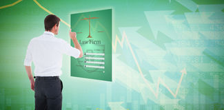 Composite image of handsome businessman pointing at a copy space. Handsome businessman pointing at a copy space against stocks and shares stock photos