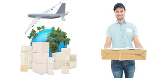 Composite image of handsome courier man with parcel Royalty Free Stock Photos