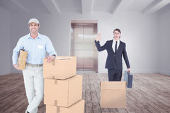 Composite image of handsome delivery man leaning on stacked cardboard boxes Stock Image