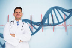 Composite image of handsome doctor with arms crossed Royalty Free Stock Image