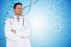 Composite image of handsome doctor with arms crossed Stock Image