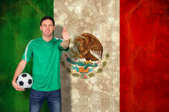 Composite image of handsome football fan in green Stock Image