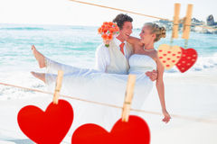 Composite image of handsome groom carrying his beautiful blonde wife Stock Images
