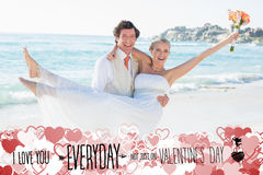 Composite image of handsome groom carrying his beautiful wife Royalty Free Stock Photos