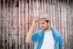 Composite image of handsome hipster wearing a trilby Royalty Free Stock Images