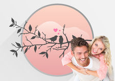 Composite image of handsome man giving piggy back to his girlfriend Stock Photo