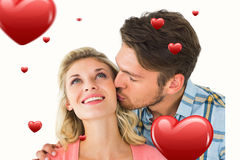 Composite image of handsome man kissing girlfriend on cheek. Handsome men kissing girlfriend on cheek against hearts Royalty Free Stock Photos