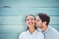 Composite image of handsome man kissing girlfriend on cheek Stock Images