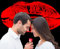 Composite image of handsome man offering his girlfriend a rose Royalty Free Stock Photography