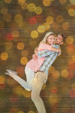 Composite image of handsome man picking up and hugging his girlfriend Royalty Free Stock Images