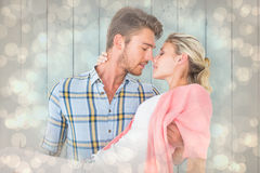 Composite image of handsome man picking up and hugging his girlfriend Royalty Free Stock Photos