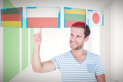 Composite image of handsome man pointing at something Stock Photos