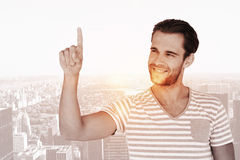 Composite image of handsome man pointing at something Royalty Free Stock Photos