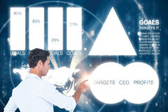 Composite image of handsome man pointing something with his finger. Handsome man pointing something with his finger  against abstract blue pattern Stock Image