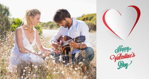 Composite image of handsome man serenading his girlfriend with guitar Stock Images