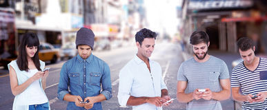 Composite image of handsome man text messaging through smart phone. Handsome men text messaging through smart phone against blurry new york street stock photos