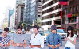 Composite image of handsome man text messaging through smart phone. Handsome men text messaging through smart phone against new york street stock photos