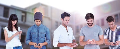 Composite image of handsome man text messaging through smart phone Royalty Free Stock Images