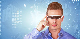 Composite image of handsome man with virtual video glasses Royalty Free Stock Photo