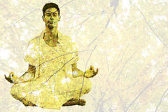Composite image of handsome man in white meditating in lotus pose Stock Images
