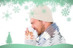 Composite image of handsome man in winter fashion blowing his nose. Handsome man in winter fashion blowing his nose against snowflakes and fir tree in green Royalty Free Stock Photography