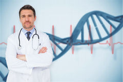 Composite image of handsome young doctor with arms crossed Stock Photography