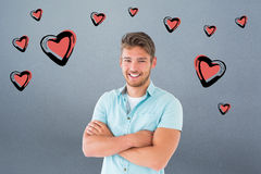Composite image of handsome young man posing with arms crossed Stock Photos