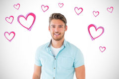 Composite image of handsome young man posing with hands in pockets Stock Photography