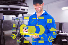 Composite image of handyman in blue overall writing on clipboard. Handyman in blue overall writing on clipboard against auto repair shop Royalty Free Stock Photos