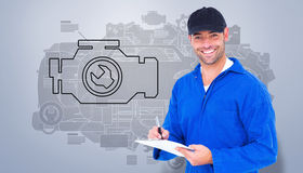 Composite image of handyman in blue overall writing on clipboard Royalty Free Stock Image